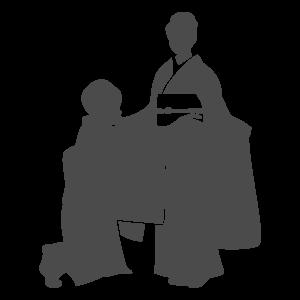 振袖の着付けをされている女性のシルエット